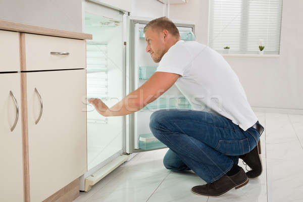 Man Looking Into An Empty Refrigerator Stock photo © AndreyPopov