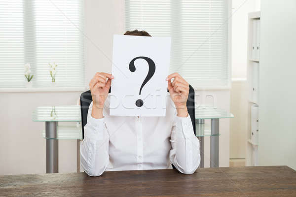 Businesswoman With Question Mark On Paper Stock photo © AndreyPopov