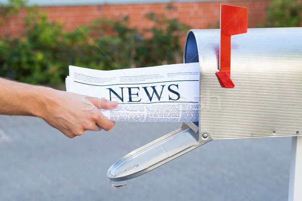 Person Hands Opening Mailbox To Remove Newspaper Stock photo © AndreyPopov