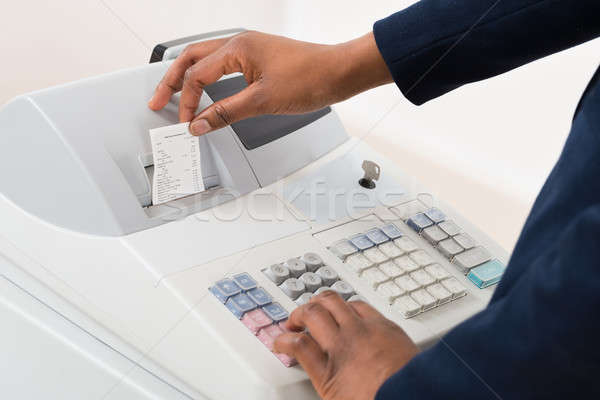 Sales Person Operating Cash Register Stock photo © AndreyPopov