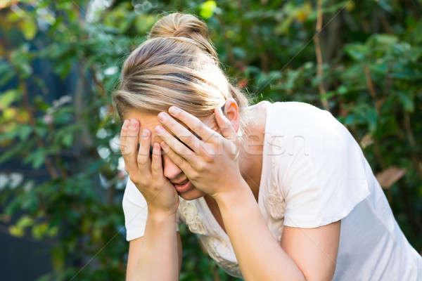 Kadın yüz eller genç kadın el üzücü Stok fotoğraf © AndreyPopov