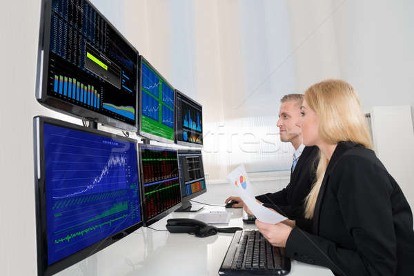 Business People Analyzing Data Displayed On Computer Screens Stock photo © AndreyPopov