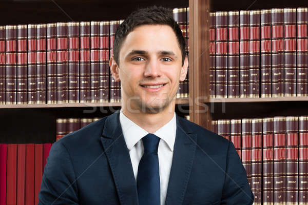 Advogado em pé prateleira de livros retrato masculino Foto stock © AndreyPopov