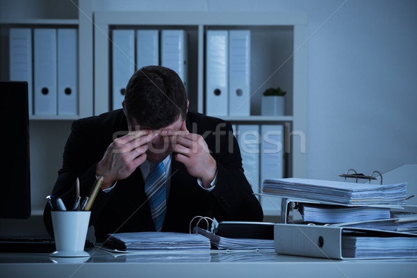 Stressed Accountant Working Late In Office Stock photo © AndreyPopov