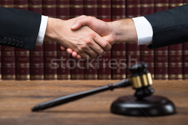 Judge And Client Shaking Hands At Courtroom Stock photo © AndreyPopov