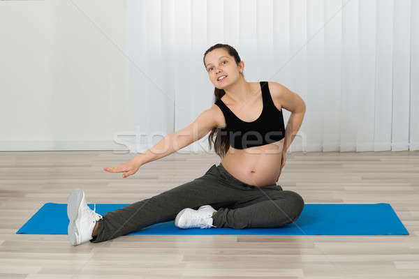Pregnant Woman Stretching Her Leg Stock photo © AndreyPopov