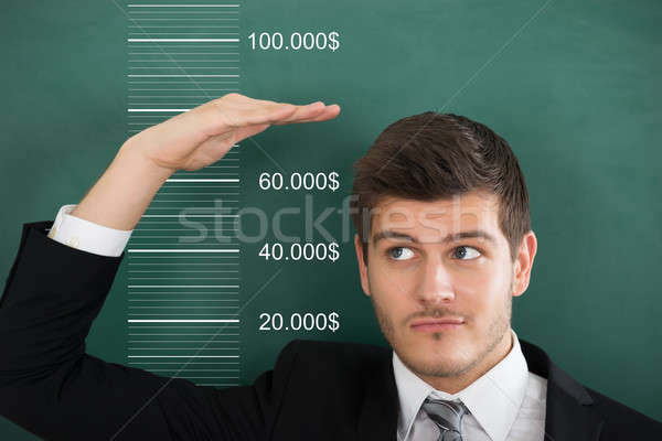 Businessman Measuring His Salary Stock photo © AndreyPopov