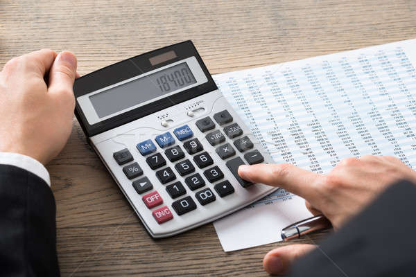 üzletember könyvelés irat számológép közelkép asztal Stock fotó © AndreyPopov