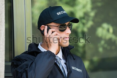 Security Guard Listening To Earpiece Stock photo © AndreyPopov