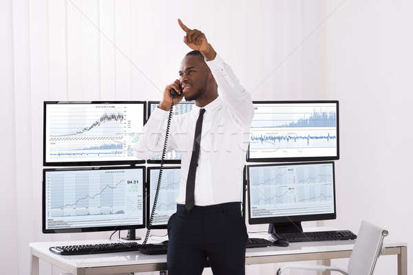 Male Stock Trader Talking On Telephone Stock photo © AndreyPopov