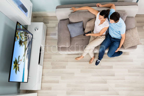 High Angle View Of Couple Watching Television Stock photo © AndreyPopov