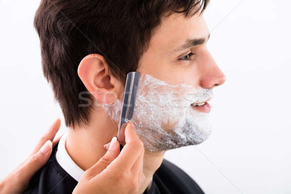 Hairdresser Shaving Man's Beard Stock photo © AndreyPopov