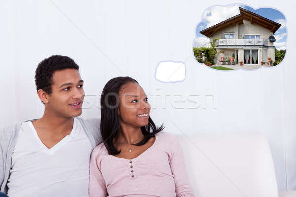 Couple Dreaming Of Getting Their Own House Stock photo © AndreyPopov
