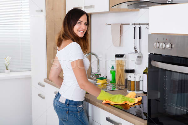 Happy Woman Cleaning The Kitchen Stock photo © AndreyPopov