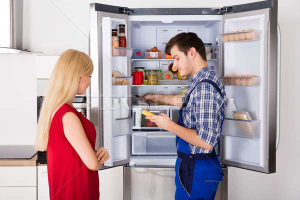 Male Technician Checking Fridge With Digital Multimeter Stock photo © AndreyPopov