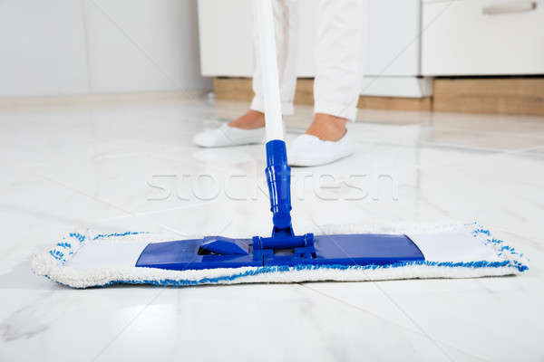 Woman Mopping The Floor In Kitchen Stock photo © AndreyPopov