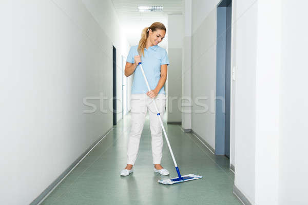Female Janitor Cleaning The Floor With Mop Stock photo © AndreyPopov