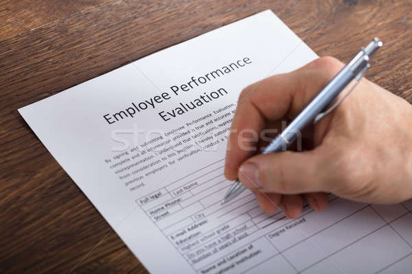 Person Filling A Performance Evaluation Form Stock photo © AndreyPopov