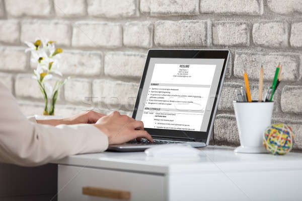 Business Person Typing Resume Stock photo © AndreyPopov