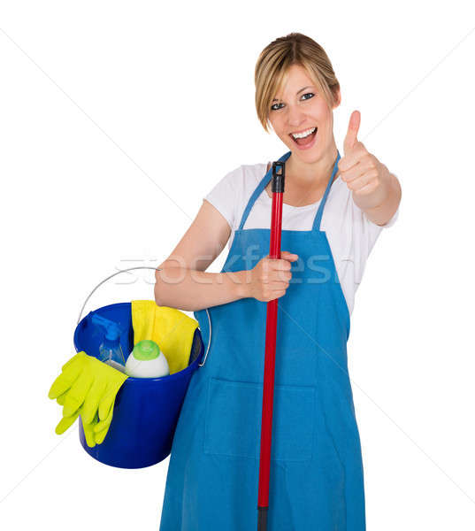 Young Happy Female Janitor With Cleaning Equipments Stock photo © AndreyPopov