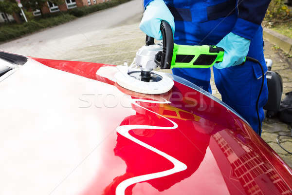 Person's Hand Polishing Car Hood Stock photo © AndreyPopov
