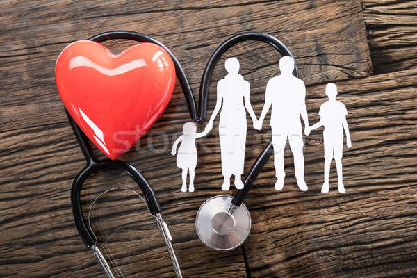 Family Cut Out And Red Heart On Desk Stock photo © AndreyPopov