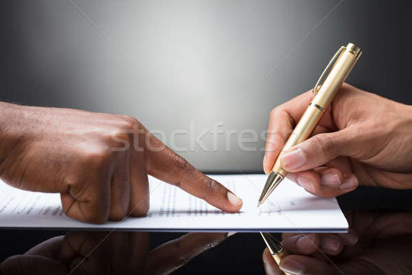 Person Signing On Document Stock photo © AndreyPopov