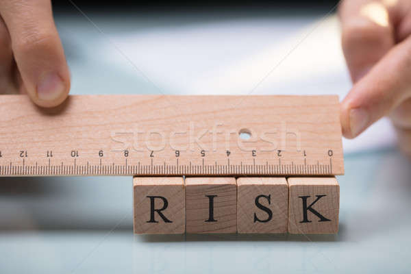 Businessperson Measuring Risk Blocks With Ruler Stock photo © AndreyPopov