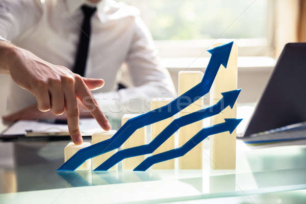 Businessperson's Finger Climbing Increasing Graph Stock photo © AndreyPopov