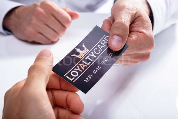 Businessman Giving Loyalty Card To His Partner Stock photo © AndreyPopov