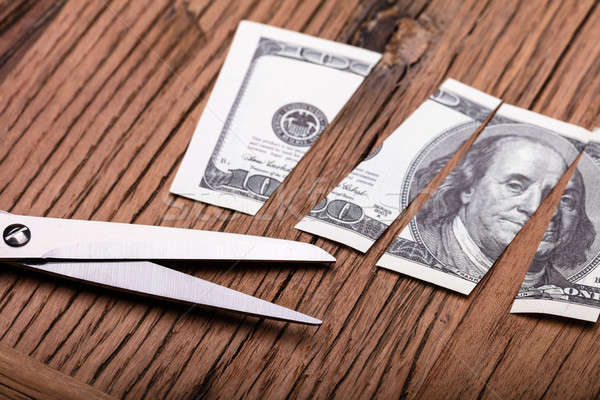 Cutted Dollar Banknote And Scissor Stock photo © AndreyPopov