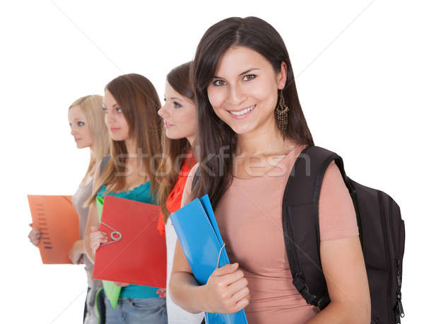 Four female students in a row Stock photo © AndreyPopov