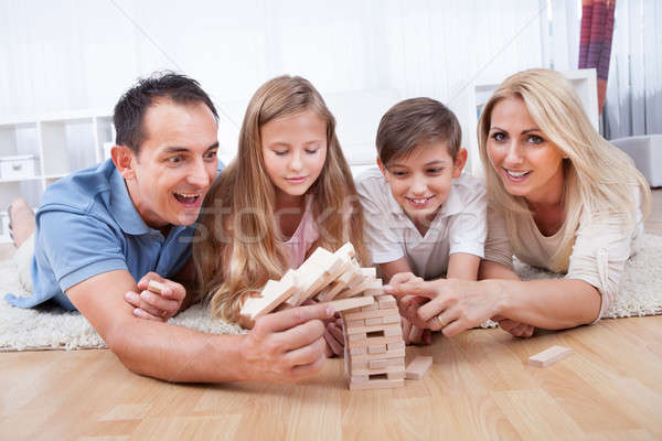 Happy Family Collapsing The Wooden Blocks Stock photo © AndreyPopov