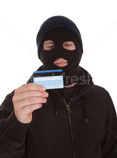 Scassinatore carta di credito indossare maschera bianco Foto d'archivio © AndreyPopov