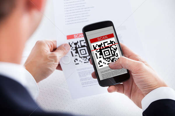 Businessman Scanning A Barcode Stock photo © AndreyPopov