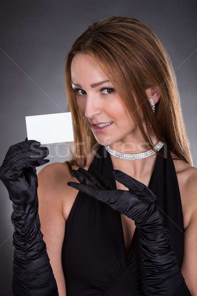 Young Woman Holding Visiting Card Stock photo © AndreyPopov