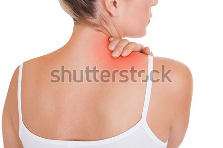Woman having back pain Stock photo © AndreyPopov