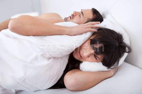 Young woman and her snoring boyfriend Stock photo © AndreyPopov