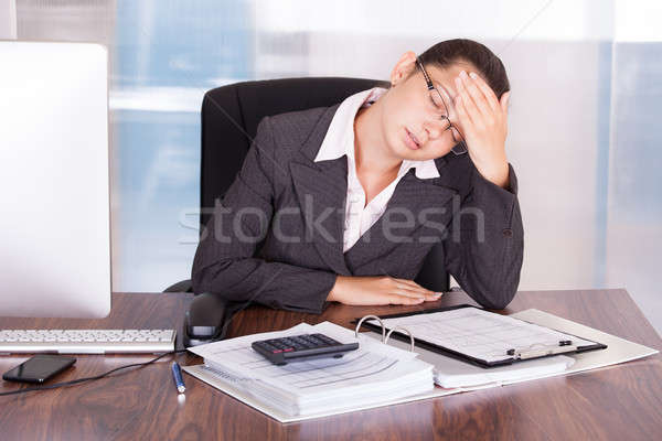 Stock photo: Young Businesswoman Suffering From Headache