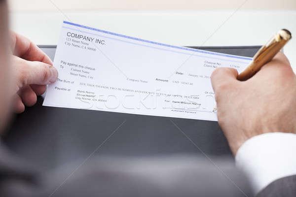 Affaires remplissage chèque argent main Photo stock © AndreyPopov