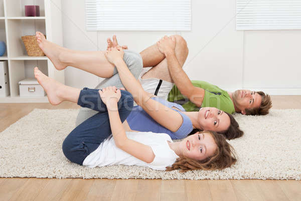Healthy Family Practicing Yoga On Rug Stock photo © AndreyPopov