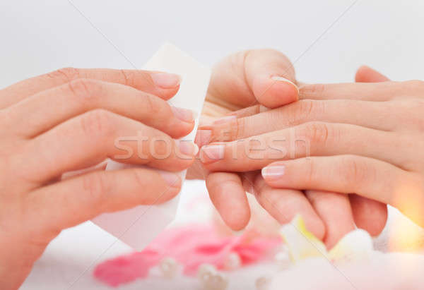 Beautician Filing The Nails Of Woman Stock photo © AndreyPopov