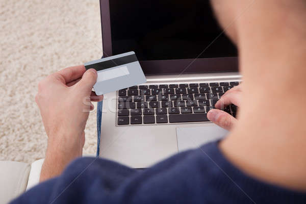 Person Holding Credit Card Using Laptop Stock photo © AndreyPopov