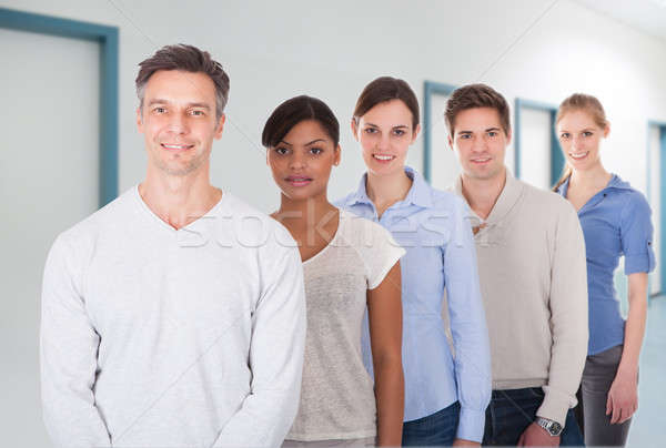 Businesspeople In Smart Casuals Standing At Office Stock photo © AndreyPopov