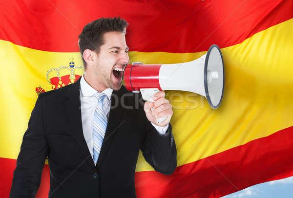 Empresário megafone bandeira espanhola tecnologia microfone Foto stock © AndreyPopov