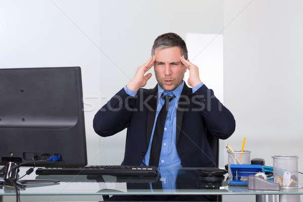 Businessman Suffering From Headache Stock photo © AndreyPopov
