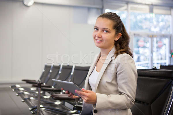 Businesswoman Using Tablet Computer At Airport Lobby Stock photo © AndreyPopov