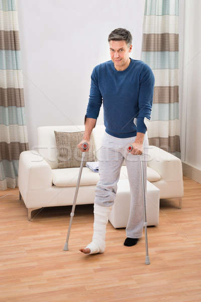 Disabled Man Using Crutches For Walking Stock photo © AndreyPopov