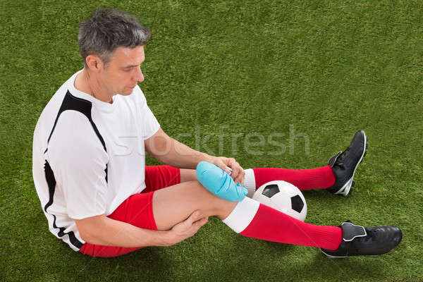 Player Icing Knee With Ice Pack Stock photo © AndreyPopov