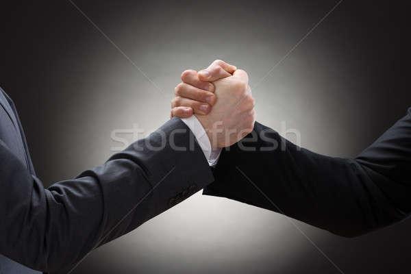 Twee zakenman arm worstelen hand Stockfoto © AndreyPopov
